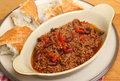Beef chilli or chili with crusty bread hot baguette Royalty Free Stock Photos
