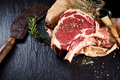 Beef cote de boeuf ribs slice and butcher knife Royalty Free Stock Photo