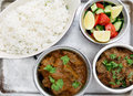 Beef curries with salad and rice Stock Images