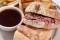 Beef dip or french dip classic au jus with fries Royalty Free Stock Photos