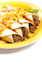 Beef enchiladas gourmet mexican food with cheese Royalty Free Stock Image