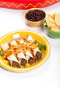 Beef enchiladas gourmet mexican food with cheese Stock Image