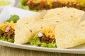 Beef fajitas mexican shredded beef fajitas soft corn tortillas served lettuce sour cream grated cheddar cheese salsa Royalty Free Stock Photography