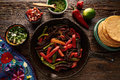 Beef fajitas in a pan with sauces Mexican food Royalty Free Stock Photo