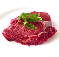 Beef fillet steak with sprig of parsley on white background, isolated Royalty Free Stock Photo