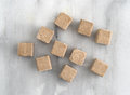 Beef flavored bouillon cubes on a gray marble cutting board Royalty Free Stock Photo