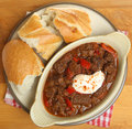 Beef goulash stew with crusty bread and soured cream Royalty Free Stock Photo