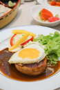 Beef Hamburg steak with egg. Royalty Free Stock Photo