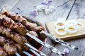 Beef kebabs in plate on the wooden table Stock Photography