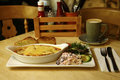Beef lasagne served with a side salad Royalty Free Stock Photo