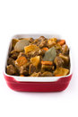 Beef meat stewed with potatoes, carrots and spices in ceramic pot isolated Royalty Free Stock Photo