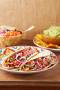 Beef meat and vegetables mexican tacos with guacamole nachos Stock Photos