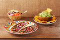 Beef meat and vegetables mexican tacos with guacamole nachos Royalty Free Stock Photo
