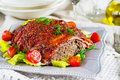 Beef meatloaf with bacon and mustard crust ketchup Royalty Free Stock Photo