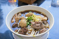 Beef noodle soup with meatballs sliced meat intestines garnished cilantro and ginger Royalty Free Stock Image