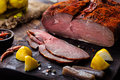 Beef pastrami sliced, roasted beef, slow cooking, marinated in olive oils eggplants on wooden board. Royalty Free Stock Photo