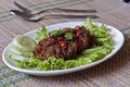 Beef rendang spicy with cucumber and salad Stock Photos