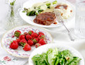 Beef with Salad and Strawberry Stock Images