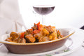 Beef saute in oval baking dish with red wine tomatoes mushrooms and onions served along Stock Photo