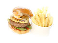 Beef and seafood burger with fries grilled tomato asparagus pineapple shrimp Royalty Free Stock Photos