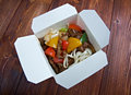 Beef slice and udon noodle chinese cuisine in take out box Royalty Free Stock Images