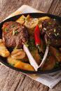 Beef steak with chili and a side dish of potatoes close up. Vert Royalty Free Stock Photo