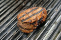 Beef steak cooking on an open flame grill Royalty Free Stock Photos