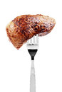 Beef steak on fork Royalty Free Stock Photo