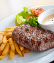 Beef steak french fries and vegetables Stock Photo
