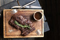 Beef steak. Piece of Grilled BBQ beef in spices Royalty Free Stock Photo