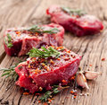 Beef steak raw on a dark wooden table Royalty Free Stock Photography