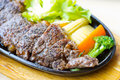 Beef steak served with hot pan Stock Photography