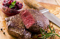 Beef Steaks on Wooden Board Stock Images