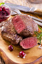 Beef steaks on wooden board as closeup a Stock Image