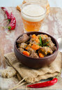 Beef stew bowl of and beer selective focus Stock Photo