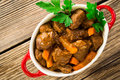 Beef stew with carrot traditional french goulash in red ceramic pot viewed from above Stock Photography