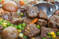 Beef stew hearty and traditional close up focus on the spoon Royalty Free Stock Image