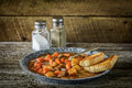 Beef stew meal plate of hearty on a rustic background Royalty Free Stock Photos