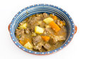 Beef stew with meat potatoes and carrots in a ceramic dish isolated on white Stock Photography