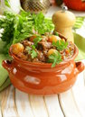 Beef stew with vegetables and herbs in a clay pot comfort food Stock Image