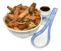 Beef stir fry meal in a traditional chinese decorated bowl isolated on a white background Stock Images