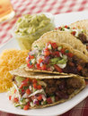 Beef Tacos with Cheese Salad and Guacamole Stock Photos