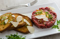 Beef tartar, toast bread with garlic Royalty Free Stock Photo