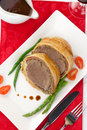 Beef wellington delicious roasted tenderloin rolled in mushroom puree and prosciutto then wrapped in puff pastry garnished Stock Photography