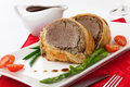 Beef wellington delicious roasted tenderloin rolled in mushroom puree and prosciutto then wrapped in puff pastry garnished Royalty Free Stock Images