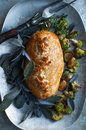 Beef wellington golden with purple sage and roasted vegetables Royalty Free Stock Photos