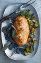 Beef wellington golden with purple sage and roasted vegetables Stock Photos