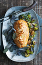 Beef wellington golden with purple sage and roasted vegetables Royalty Free Stock Photo