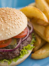 Beefburger with Salad and Pickles in a bun Royalty Free Stock Photo