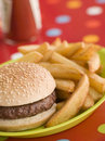 Beefburger in a Sesame Seed Bun with Chunky Chips Stock Photo